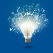 Conceptual image of electric bulb against blue background