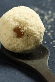 stock photo of laddu  - Rava Laddu or Laddoo is an Indian and Bengali sweet that is often prepared to celebrate festivals or household events such as weddings - JPG