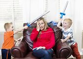 stock photo of overwhelming  - Young Mother overwhelmed by her kids - JPG