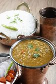 stock photo of tadka  - Mixed dal made of boiled lentils cooked with fresh Indian spices and vegetables - JPG
