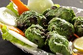stock photo of kababs  - Hariyali kabab is a Punjabi style chicken tikka or kabab made with combination of mint and coriander.