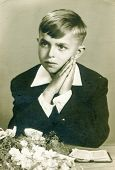 LODZ, POLAND, SEVENTIES - Vintage photo of little boy at his First Communion