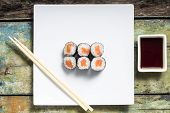 Makisushi On White Plate. Seafood Traditional Maki Sushi Rolls With Chopsticks
