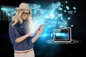 Digital composite of stylish blonde using tablet pc with interfaces and email icons