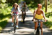 pic of exercise bike  - Friends riding their bikes in sunny countryside enjoy sport - JPG