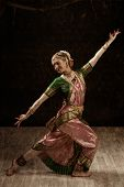stock photo of bharatanatyam  - Vintage retro style image of young beautiful woman dancer exponent of Indian classical dance Bharatanatyam - JPG