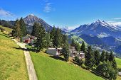 Gorgeous weather in the resort town of Leysin in the Swiss Alps. Picturesque gentle alpine meadows a