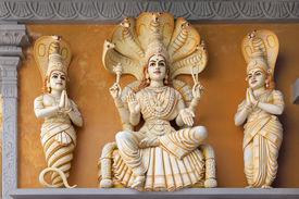 stock photo of hindu  - Hindu God Yoga Sutra of Patanjali Statue on Exterior of Hindu Temple - JPG