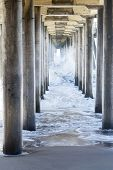 picture of rough-water  - Waves generated by a storm rush through the underside of a pier - JPG