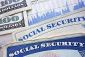picture of social-security  - Social Security cards cash and stock market chart - JPG
