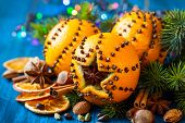 picture of christmas spices  - Oranges pierced with cloves - JPG