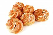 stock photo of eclairs  - fresh creamy eclair cakes served on white - JPG