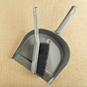 stock photo of sweeper  - Dustpan and brush floor sweeper on carpet floor - JPG