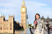 stock photo of big-girls  - London woman happy by Big Ben laughing and drinking coffee in autumn - JPG