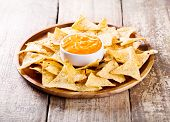 picture of nachos  - plate of nachos with cheese on wooden table - JPG