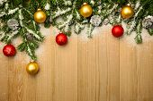 picture of weihnachten  - Christmas background with fresh firtree and  baubles on wood with bright snow  - JPG