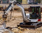 pic of excavator  - Excavator with demolition hammer in a construction site - JPG