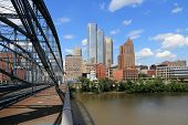 stock photo of bridge  - Pittsburgh skyline seen from Smithfield Street Bridge with Monongahela River - JPG