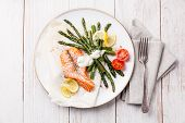 stock photo of white asparagus  - Grilled salmon with asparagus on white wooden background - JPG