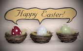 pic of easter basket eggs  - Spotlight To Three Colorful Red Blue And Green Dotted Easter Eggs In Easter Baskets Or Nest On White Wooden Background With Comic Speech Balloon With English Text Happy Easter Used As Easter Decoration Or Easter Greetings Vintage Or Old Fashion - JPG