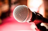 picture of microphone  - Close up of microphone in karaoke room or conference room - JPG