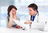 stock photo of hypertensive  - Medical Doctor man and patient woman in hospital - JPG