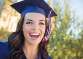 picture of graduation gown  - Happy Graduating Mixed Race Woman In Cap and Gown Celebrating on Campus - JPG
