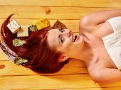 picture of sauna  - Young woman in sauna with soap - JPG