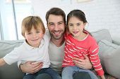 picture of daddy  - Portrait of cheerful daddy with kids - JPG