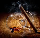 stock photo of cigar  - Cigar and almost empty glass of cognac - JPG