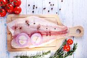 stock photo of pangasius  - Pangasius fillet with herb - JPG