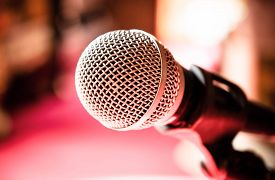stock photo of karaoke  - Close up of microphone in karaoke room or conference room - JPG
