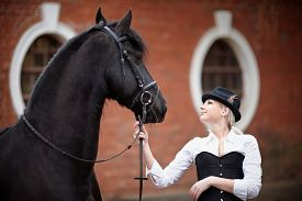 picture of horse girl  - Portrait of the girl and black horse - JPG