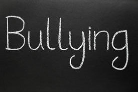 picture of school bullying  - Bullying written with white chalk on a blackboard - JPG
