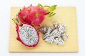 image of dragon fruit  - dragon fruit slicing on chop block in white background - JPG