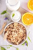 foto of cereal bowl  - bowl of cereal with milk and orange  - JPG