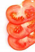 stock photo of extreme close-up  - sliced tomato on white - JPG