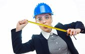 picture of pouting  - Pout engineer woman with measure tape isolated on white background - JPG