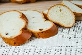 picture of fresh slice bread  - Sliced fresh handmade bread on a tablecloth - JPG