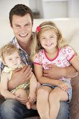 picture of father daughter  - Father Relaxing with Daughters At Home - JPG