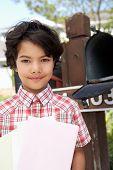 stock photo of mailbox  - Hispanic Boy Checking Mailbox - JPG