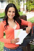 picture of mailbox  - Hispanic Woman Checking Mailbox - JPG