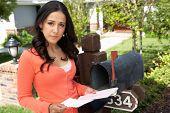 foto of mailbox  - Hispanic Woman Checking Mailbox - JPG
