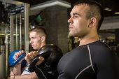 foto of kettlebell  - Kettlebell swing training of two young men in the gym - JPG