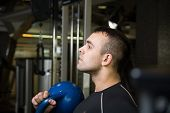 stock photo of kettlebell  - Kettlebell swing workout training man at gym - JPG