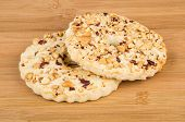 foto of shortbread  - Two shortbreads rings with peanuts on wooden bamboo table - JPG
