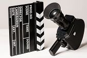 foto of shoot out  - Old movie camera with film clapperboard - JPG