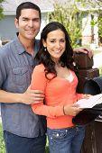 image of mailbox  - Hispanic Couple Checking Mailbox - JPG