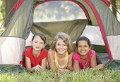 stock photo of tent  - Group Of Girls Having Fun In Tent In Countryside - JPG