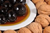 pic of walnut  - Jam from walnuts on a saucer and walnuts - JPG